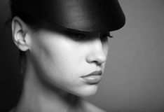 Young lady with hat Royalty Free Stock Images