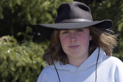 Young lady with hat. Young lady with Autralian style hat Royalty Free Stock Photos
