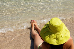 Young lady with hat on beach Stock Image