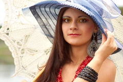 Young lady in hat with an umbrella Royalty Free Stock Image