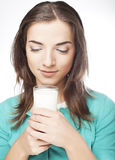 Young lady having a glass of milk Royalty Free Stock Images