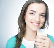 Young lady having a glass of milk Royalty Free Stock Photo