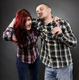 Young lady and her drunk husband Royalty Free Stock Photography
