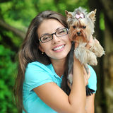 Young lady with her puppy in a park Stock Photos