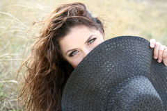 Young  lady hiding  behind the bonnet Stock Photo