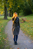 Young lady hiding face behind bunch of leaves Royalty Free Stock Photo