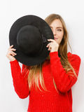 Young lady hiding her face. Stock Photography
