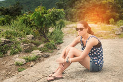 Young lady hiker enjoying view point. From top of a mountain stock photography