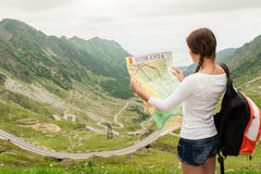 Young lady hiker holding map Royalty Free Stock Images
