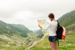 Young lady hiker holding map Stock Photos