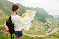 Young lady hiker holding map Royalty Free Stock Photo