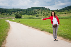 Young lady hitchhiking Stock Photos