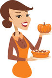 Young lady holding baked pumpkin pie Royalty Free Stock Image
