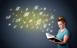 Young lady holding book with letters Stock Image