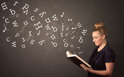 Young lady holding book with letters Stock Photo