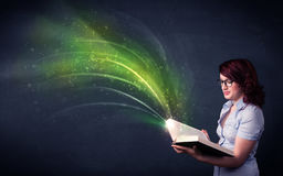 Young lady holding book with wave Stock Photos