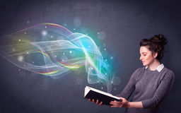 Young lady holding book with waves Stock Photos