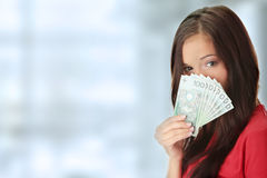 Young lady holding cash Royalty Free Stock Photos