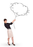 Young lady holding cloud balloon drawing Royalty Free Stock Photo