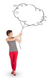 Young lady holding cloud balloon drawing Royalty Free Stock Photography