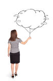 Young lady holding cloud balloon drawing Royalty Free Stock Photos