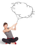 Young lady holding cloud balloon drawing Royalty Free Stock Images