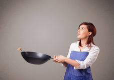 Young lady holding a frying pan Royalty Free Stock Images