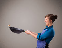 Young lady holding a frying pan Stock Photography