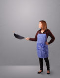 Young lady holding a frying pan Stock Photo