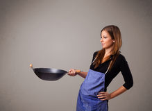 Young lady holding a frying pan Royalty Free Stock Photo