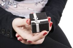 Young lady holding gift in her hands Royalty Free Stock Photography