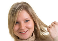 Young lady holding her hair. Head portrait of attractive young adult lady holding her hair and smiling. isolated on white background. Copy space Stock Images