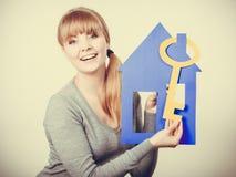 Young lady holding housing symbols. Stock Image