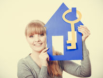 Young lady holding housing symbols. Stock Photography