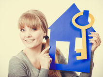 Young lady holding housing symbols. Stock Images
