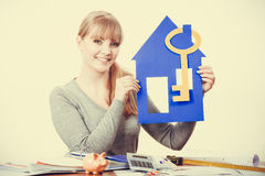 Young lady holding housing symbols. Royalty Free Stock Photography
