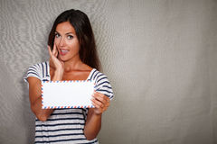 Young lady holding letter while looking impressed Royalty Free Stock Photo