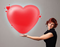 Young lady holding lovely 3d red heart Royalty Free Stock Photo