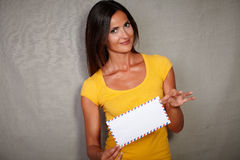 Young lady holding mail while looking at camera Royalty Free Stock Photos