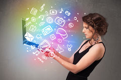 Young lady holding notebook with colorful hand drawn multimedia Royalty Free Stock Images