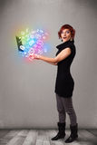 Young lady holding notebook with colorful hand drawn multimedia Stock Images
