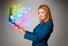 Young lady holding notebook with colorful hand drawn multimedia Stock Image