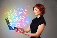 Young lady holding notebook with colorful hand drawn multimedia Stock Photos