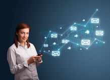 Young lady holding a phone with arrows and message icons Royalty Free Stock Photo