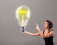 Young lady holding realistic 3d light bulb Stock Photography