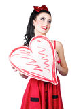 Young lady holding retro red heart card Royalty Free Stock Images