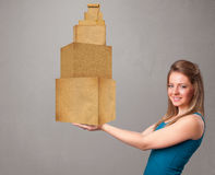 Young lady holding a set of brown cardboard boxes Stock Image