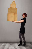 Young lady holding a set of brown cardboard boxes Royalty Free Stock Image