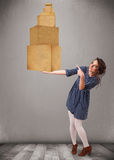Young lady holding a set of brown cardboard boxes Royalty Free Stock Photography