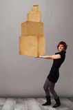 Young lady holding a set of brown cardboard boxes Royalty Free Stock Photos